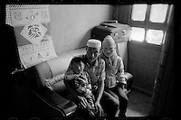 A Muslim couple poses with their son before the boy leaves their home in Hualong for a cleft palate operation organized by Smile Angel Foundation at  hospitals in Xining, Qinghai province, China, August 2013. (Names withheld for privacy)