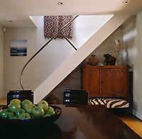 The stairs at one end of the dining room lead up to a seldom used attic space