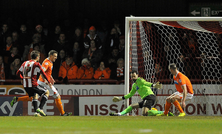 Brentford's Jon Toral scores the opening goal against Blackpool<br /> <br /> Photographer Ashley Western/CameraSport<br /> <br /> Football - The Football League Sky Bet League One - Brentford v Blackpool - Tuesday 24th February 2015 - Griffin Park - London<br /> <br /> &copy; CameraSport - 43 Linden Ave. Countesthorpe. Leicester. England. LE8 5PG - Tel: +44 (0) 116 277 4147 - admin@camerasport.com - www.camerasport.com