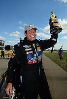 May 20, 2012; Topeka, KS, USA: NHRA top fuel dragster driver David Grubnic celebrates after winning the Summer Nationals at Heartland Park Topeka. Mandatory Credit: Mark J. Rebilas-
