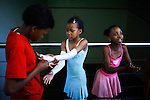 SOWETO, SOUTH AFRICA OCTOBER 25: Young ballroom dancers dress before a dress rehearsal in a community hall in Pimville Community center on October 25, 2006 in Soweto, Johannesburg, South Africa. Ballroom dancing is very popular sport in the township and all over the country. Soweto is South Africa&rsquo;s largest township and it was founded about one hundred years to make housing available for black people south west of downtown Johannesburg. The estimated population is between 2-3 million. Many key events during the Apartheid struggle unfolded here, and the most known is the student uprisings in June 1976, where thousands of students took to the streets to protest after being forced to study the Afrikaans language at school. Soweto today is a mix of old housing and newly constructed townhouses. A new hungry black middle-class is growing steadily. Many residents work in Johannesburg, but the last years many shopping malls have been built, and people are starting to spend their money in Soweto.  <br /> (Photo by Per-Anders Pettersson)