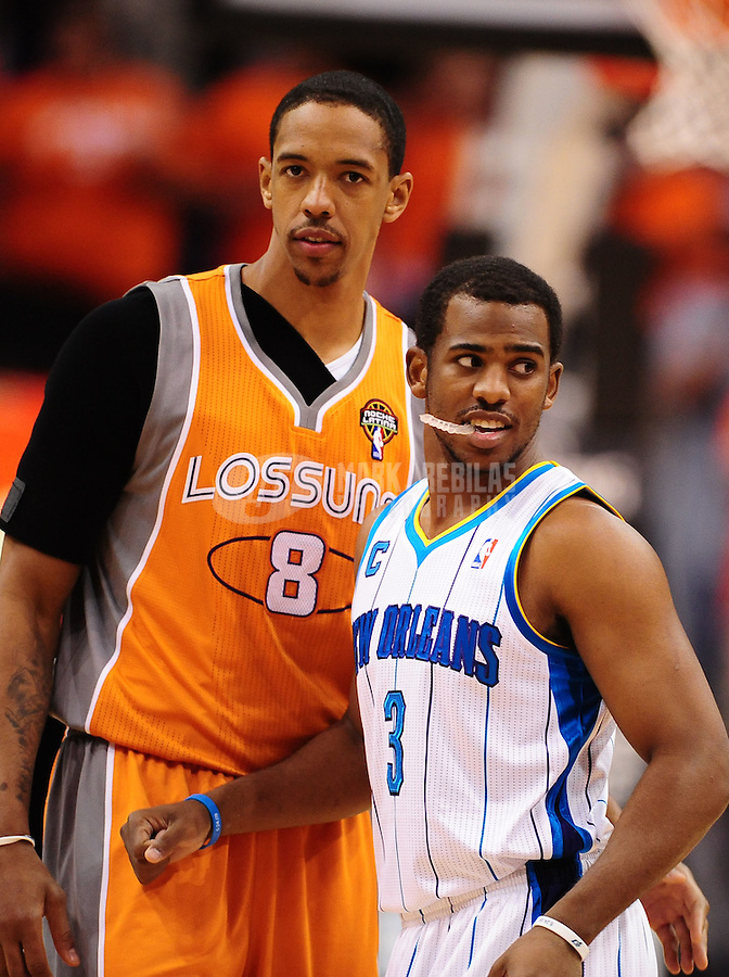 Mar. 25, 2011; Phoenix, AZ, USA; New Orleans Hornets guard (3) Chris Paul greets Phoenix Suns center Channing Frye at the US Airways Center. The Hornets defeated the Suns 106-100. Mandatory Credit: Mark J. Rebilas-