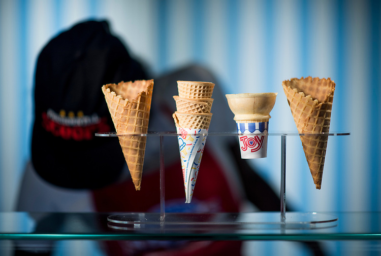 UNITED STATES - AUGUST 2: Ice cream cones sit on the counter at Presidential Scoops as an employee scoops ice cream at the store in Washington on Thursday, Aug. 2m 2018. (Photo By Bill Clark/CQ Roll Call)