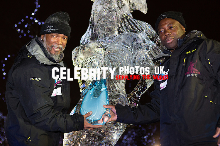 Team Africa pose with their winning ice sculpture and award at the London Ice Sculpting Festival 2014. Photo by Vickie Flores.