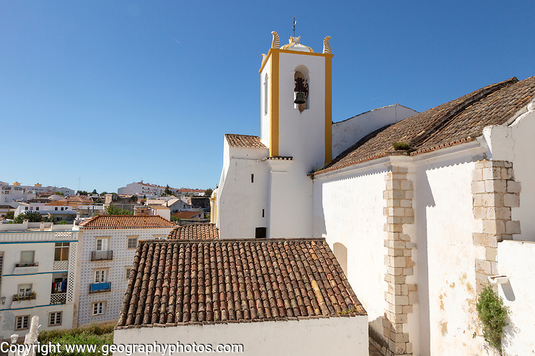 Whitewashed exterior walls and tower of Roman Catholic church Igreja de Santiago, Tavira, Algarve, Portugal, southern Europe