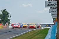 6-8 August, 2010, Watkins Glen, New York USA.Restart: Juan Pablo Montoya (#42) is challeged by Marcos Ambrose (#47)..©2010 F.Peirce Williams, USA.