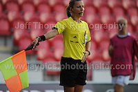 An assistant referee instructs a corner during the UEFA Womens U19 Championships at Parc y Scarlets, Monday 19th August 2013. All images are the copyright of Jeff Thomas Photography-www.jaypics.photoshelter.com-07837 386244-Any use of images must be authorised by the copyright owner.
