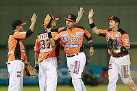 Jonathan Navarro y Joan Jose Aguilar festejan triunfo de naranjeros , durante el juego a beisbol de Naranjeros vs Cañeros durante la primera serie de la Liga Mexicana del Pacifico.<br /> 15 octubre 2013