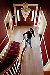 University of California, Merced student Jaron Brandon walks down the staircase in the spacious rental home he shares in Merced, Calif., October 29, 2011.