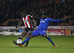 Clayton Donaldson of Sheffield Utd tackled by Bruno Manga of Cardiff City during the Championship match at Bramall Lane Stadium, Sheffield. Picture date 02nd April, 2018. Picture credit should read: Simon Bellis/Sportimage