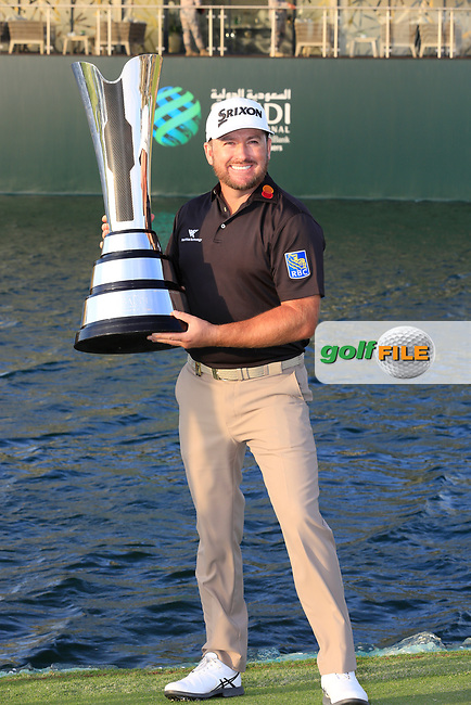 Graeme McDowell (NIR) on the 18th green with the winners trophy after the final round of  the Saudi International powered by Softbank Investment Advisers, Royal Greens G&CC, King Abdullah Economic City,  Saudi Arabia. 02/02/2020<br /> Picture: Golffile | Fran Caffrey<br /> <br /> <br /> All photo usage must carry mandatory copyright credit (© Golffile | Fran Caffrey)