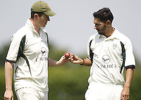North London captain Jack Atchinson (L) in discussion with Anees Davids (R)during the Middlesex County Cricket League Division Three game between Wembley and North London at Vale Farm, Wembley on Sat May 31, 2014