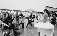 07 May 1969 --- Photographers photograph a young woman passenger aboard the Queen Elizabeth II cruise liner at the west pier in New York Harbor during the liner's maiden voyage from Southampton, England to New York City. --- Image by © JP Laffont