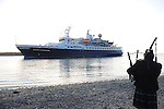 A lone piper (Jack Power from Trim) welcomes the Clipper Adventurer cruise ship as it enters the mouth of the river Boyne at Mornington on it's way to the port of Drogheda. This is the first time in the history of the port that ti has played host to a cruise vessel. Photo: Colin Bell/pressphotos.ie