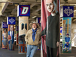 Brother Mark Elder, C.M., an adjunct faculty member in DePaul&rsquo;s art, media and design program, and his students have been working to install murals under the Fullerton &quot;L&quot; Station in Lincoln Park that highlight DePaul University's history in Chicago. <br /> <br /> Elder's artistic retrospective, titled &ldquo;The Story of &lsquo;The Little School Under the &lsquo;L&rsquo;&rsquo;, will eventually feature 25 murals permanently installed on the massive concrete pillars that support the &quot;L&quot; station nearest the university's Lincoln Park Campus. (DePaul University/Jamie Moncrief)