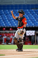 Miami Marlins catcher Nick Fortes (12) signals to the defense during a Florida Instructional League game against the Washington Nationals on September 26, 2018 at the Marlins Park in Miami, Florida.  (Mike Janes/Four Seam Images)