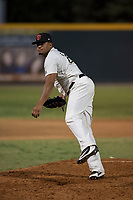 Visalia Rawhide relief pitcher Junior Garcia (29) follows through on his delivery during a California League game against the Stockton Ports at Visalia Recreation Ballpark on May 8, 2018 in Visalia, California. Stockton defeated Visalia 6-2. (Zachary Lucy/Four Seam Images)