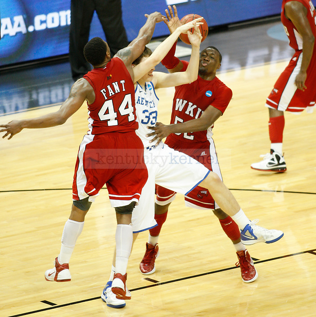UK forward Kyle Wiltjer fights for possession of the ball off a rebound with Western Kentucky guard T.J. Price and forward George Fant during the UK vs. WKU NCAA second round game at the KFC Yum! Center March 15, 2012. Photo by Brandon Goodwin | Staff