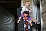 Justin Griffith, a sergeant in the US Army, an atheist and a father, carries  his 1-year-old daughter Zoe Griffith on his shoulders into his apartment in Fayetteville, NC, on Sunday, March 11, 2012.  Recently named as Military Director of American Atheists, Justin Griffith is trying to get atheists more respect within the military and has organized a pro-atheism event, Rock Beyond Belief, at Fort Bragg, where he is stationed.  Photo by Ted Richardson