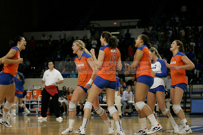 Florida celebrates after a successful play during the UK volleyball game against Florida at Memorial Coliseum on Sunday, Nov. 22, 2009. No. 10 UK lost to No. 13 Florida (3-1). Photo by Adam Wolffbrandt | Staff