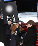 Lorin Latarro and Lisa Goldberg attend The Ghostlight Project to light a light and make a pledge to stand for and protect the values of inclusion, participation, and compassion for everyone - regardless of race, class, religion, country of origin, immigration status, (dis)ability, gender identity, or sexual orientation at The TKTS Stairs on January 19, 2017 in New York City.
