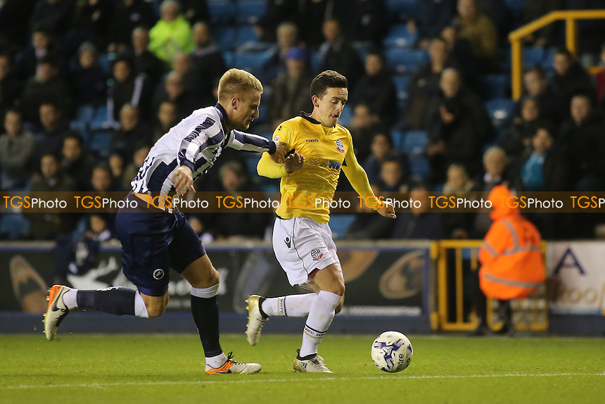 Bolton's Zach Clough tries to shake off a challenge from Millwall's Byron Webster during Millwall vs Bolton Wanderers, Sky Bet EFL League 1 Football at The Den on 18th October 2016