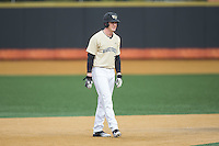 Kevin Conway (7) of the Wake Forest Demon Deacons takes his lead off of second base against the Harvard Crimson at David F. Couch Ballpark on March 5, 2016 in Winston-Salem, North Carolina.  The Crimson defeated the Demon Deacons 6-3.  (Brian Westerholt/Four Seam Images)