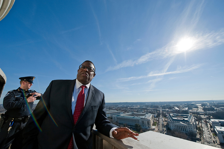UNITED STATES - Dec 19: Project manager Eugene Poole of the AOC talk about work that will be done to the dome in the coming months with a view behind him to the South from the top of the US Capitol dome during a tour of the dome December 19, 2013 in Washington, DC. The Dome has not undergone a complete restoration since 1959-1960 and due to age and weather is now plagued by more than 1,000 cracks and deficiencies. The Architect of the Capitol began in November, a multi-year project to repair these deficiencies, restoring the Dome to its original, inspiring splendor.  (Photo By Douglas Graham/CQ Roll Call)