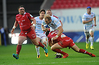 Racing 92 Antonie Claassen is tackled by Scarlets' Leigh Halfpenny<br /> <br /> Photographer Ian Cook/CameraSport<br /> <br /> European Rugby Champions Cup - Scarlets v Racing 92 - Saturday 13th October 2018 - Parc y Scarlets - Llanelli<br /> <br /> World Copyright &copy; 2018 CameraSport. All rights reserved. 43 Linden Ave. Countesthorpe. Leicester. England. LE8 5PG - Tel: +44 (0) 116 277 4147 - admin@camerasport.com - www.camerasport.com