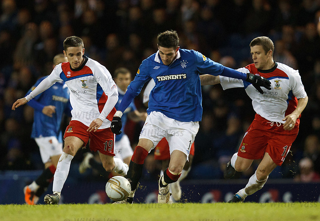 Kyle Lafferty squeezes past Nick Ross and Chris Innes