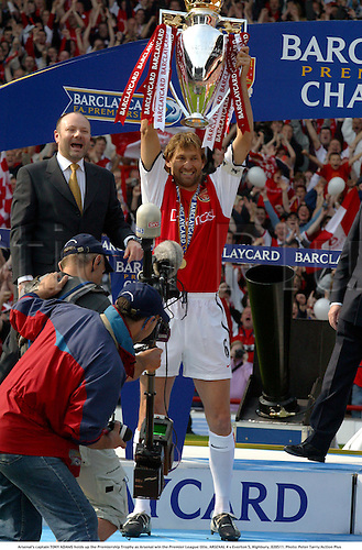 Arsenal's captain TONY ADAMS holds up the Premiership Trophy as Arsenal win the Premier League title, ARSENAL 4 v Everton 3, Highbury, 020511. Photo: Peter Tarry/Action Plus...2002.soccer association football.premier league premiership english league.licenced cup winners winner.celebrations celebration.celebrates celebrate.joy celebrating