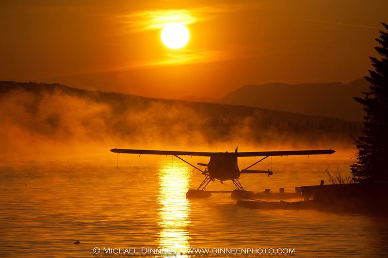 Float Plane Beluga Lake Homer, Alaska.  Morning fog combined with forest fire smoke.