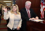 Nevada Assemblywoman Michele Fiore, R-Las Vegas, apologizes to her fellow Assembly members for &quot;storming off&quot; after a roll call vote killed her effort to save the campus carry bill at the Legislative Building in Carson City, Nev., on Thursday, May 21, 2015. Assembly Speaker John Hambrick, R-Las Vegas, right, initially banned Fiore from the floor for the day but reversed his decision after Fiore's apology. <br /> Photo by Cathleen Allison