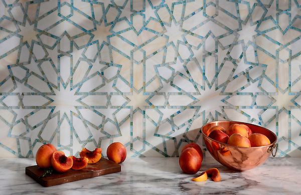 Castilla, a jewel glass waterjet and hand-cut mosaic shown in Quartz and Aquamarine, is part of the Miraflores collection by Paul Schatz for New Ravenna Mosaics.