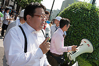 Makoto Sakurai,founder and leader of Zaitokukai, anti-foreigner hate group talks outside  Yasukuni Shrine, Kudashita, Tokyo, Japan Saturday August 15th 2009. On August 15th every year people gather at Yasukuni Shrine to commemorate the end of the Pacific War. Notionally a call for remembrance and continued peace it is also a Mecca for right wing nationalist and the paramilitary Uyoku dantai.