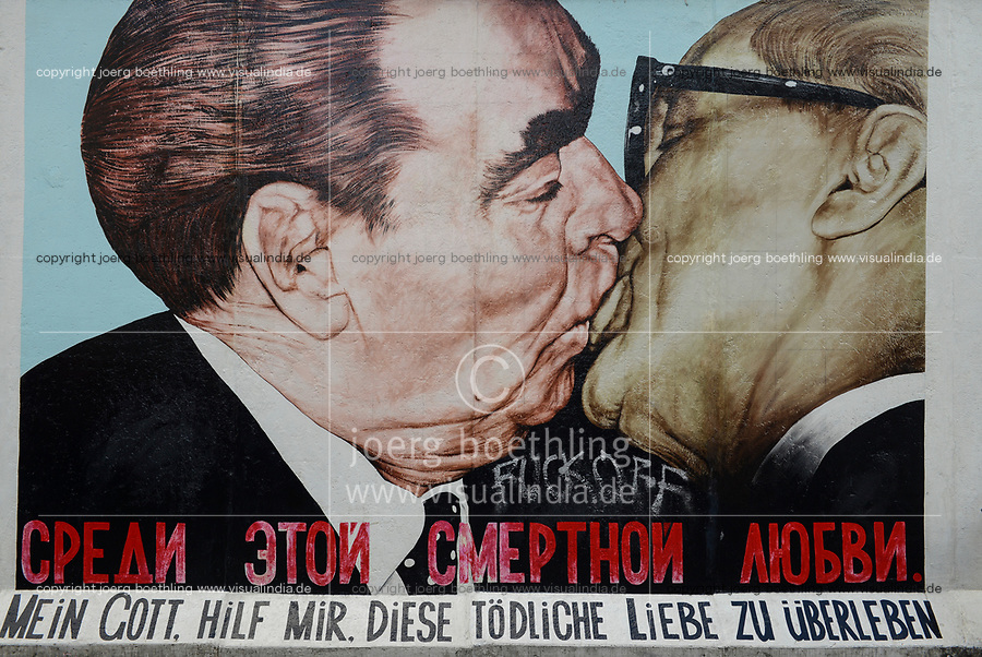 Germany, Berlin, The wall, East side gallery, wall paintíngs and murals about the cold war and walls, painting the kiss of soviet leader Breshnev and east german leader Erich Honecker by Dimitry Vrubel, after a photograph of Régis Bossu taken in Oct. 1979, written below: My god help me to survive this deadly love