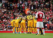 1st October 2017, Emirates Stadium, London, England; EPL Premier League Football, Arsenal versus Brighton; Brighton form a group huddle before kick off, as Alexandre Lacazette of Arsenal prepares to kick off