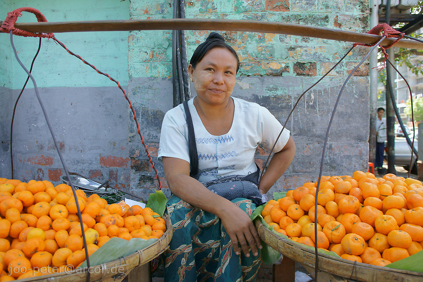 woman with selling fruits on the streets of Yangon, Myanmar, 2011