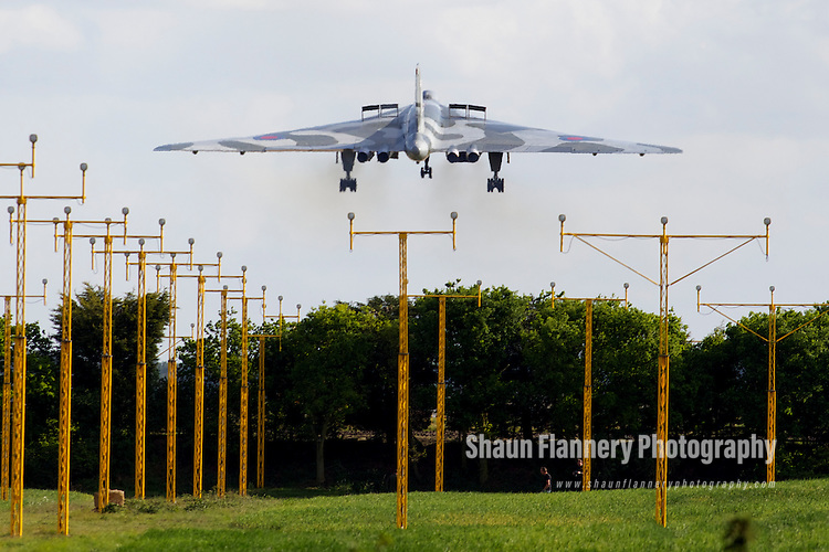 Pix: Shaun Flannery/shaunflanneryphotography.com...COPYRIGHT PICTURE>>SHAUN FLANNERY>01302-570814>>07778315553>>..8th May 2011............Vulcan xh558 lands at Robin Hood Airport Doncaster Sheffield after a display at the Abingdon Air Show.