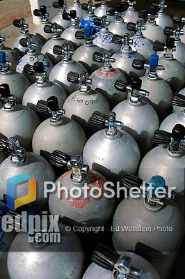 14 August 2007: Dozens of SCUBA air tanks are full and ready for use outside the dive shop at Captain Don's Habitat, on the Dutch Island of Bonaire. Bonaire, known for its pioneering role in the preservation of the marine environment, is part of the Netherlands Antilles grouping of islands. Located in the southern Caribbean, off the coast of Venezuela, Bonaire is renowned for its excellent scuba diving, snorkeling, and windsurfing. ..Mandatory Photo Credit: Ed Wolfstein Photo