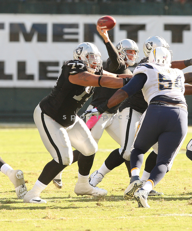 Oakland Raiders Austin Howard (77) during a game against the San Diego Chargers on October 12, 2014 at O.co Coliseum in Oakland, CA. The Chargers beat the Raiders 31-28.