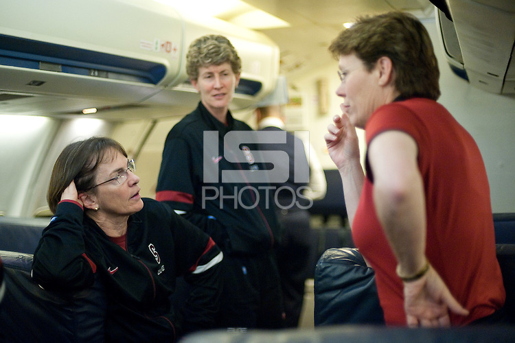 OKLAHOMA CITY, OK--Tara Van derVeer speaks with Director of Women's Basketball Operations Eileen Roche and Assistant Coach Amy Tucker during a refuel layover in Oklahoma City, en route to Norfolk, VA for the first and second rounds of the 2012 NCAA tournament.
