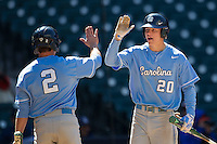 North Carolina Tar Heels outfielder Skye Bolt #20 congratulates teammate Chaz Frank #2 after he scored against the California Golden Bears in the NCAA baseball game on March 2nd, 2013 at Minute Maid Park in Houston, Texas. North Carolina defeated Cal 11-5. (Andrew Woolley/Four Seam Images).