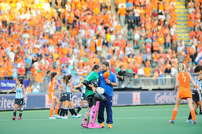 The Hague, Netherlands, June 12: Head coach Max Caldas of The Netherlands hugs Belen Succi #1 of Argentina after the field hockey semi-final match (Women) between The Netherlands and Argentina on June 12, 2014 during the World Cup 2014 at Kyocera Stadium in The Hague, Netherlands. Final score 4-0 (3-0)  (Photo by Dirk Markgraf / www.265-images.com) *** Local caption ***