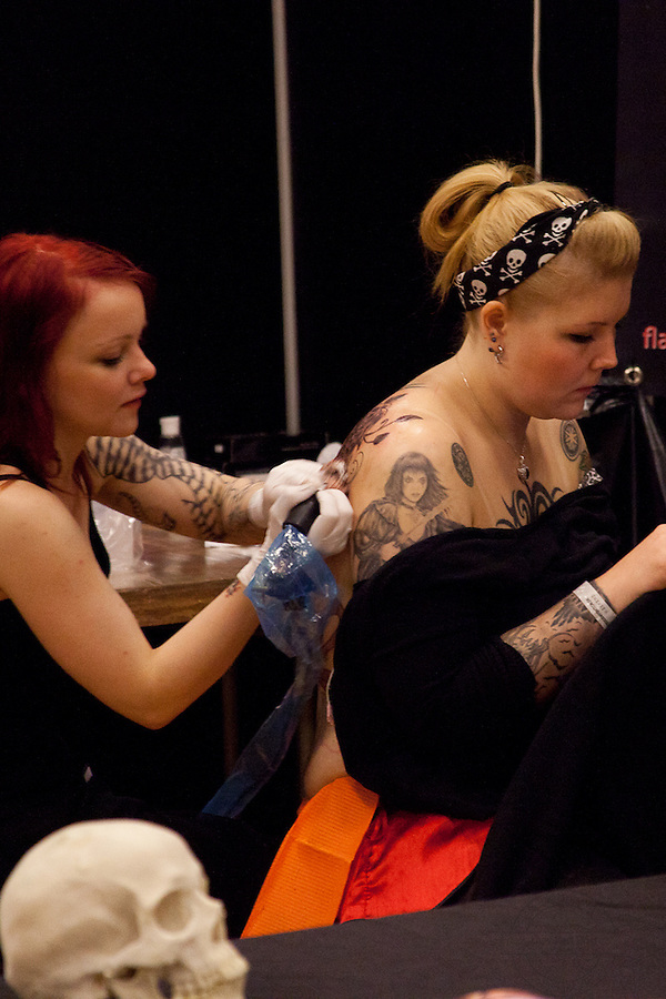 Tattoo Convention in Kolding 2011. Arranged by BodyMod.dk<br /> Tattoo artist at work.
