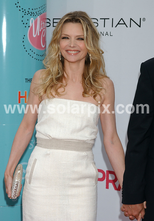 **ALL ROUND PICTURES FROM SOLARPIX.COM**.**WORLDWIDE SYNDICATION RIGHTS EXCLUDING - FRANCE** .The premiere of the film, Hairspray in Westwood, Ca, USA. at the Village Theater on July 10, 2007..This pic: Michelle Pfeiffer..JOB REF:   4246    GLS       DATE: 11_07_2007.**MUST CREDIT SOLARPIX.COM OR DOUBLE FEE WILL BE CHARGED* *UNDER NO CIRCUMSTANCES IS THIS IMAGE TO BE REPRODUCED FOR ANY ONLINE EDITION WITHOUT PRIOR PERMISSION*
