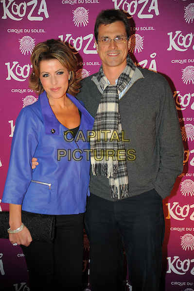 Natasha Kaplinsky & Justin Bower.Opening night of  the Cirque du Soleil's 'Kooza' at the Royal Albert Hall - Arrivals.London, England..January 8th, 2013.half length jacket blue scarf check glasses  grey gray  married husband wife .CAP/CAS.©Bob Cass/Capital Pictures.