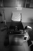 An abortion room in countryside clinic, China. The room and chair is used to give women abortions. It is estimated that 50% of pregnancies in China are aborted resulting in 400 million fewer chinese since the controversial birth policy was started 30 years ago.