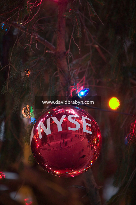 18 December 2006 - New York City, NY - Decorative balls hang from a giant Christmas tree placed in front of the New York Stock Exchange in the financial district of Manhattan in New York City, NY, 18 December 2006.