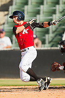 David Herbek #12 of the Kannapolis Intimidators follows through on his swing against the Hickory Crawdads at CMC-Northeast Stadium on April 8, 2012 in Kannapolis, North Carolina.  The Intimidators defeated the Crawdads 12-11.  (Brian Westerholt/Four Seam Images)
